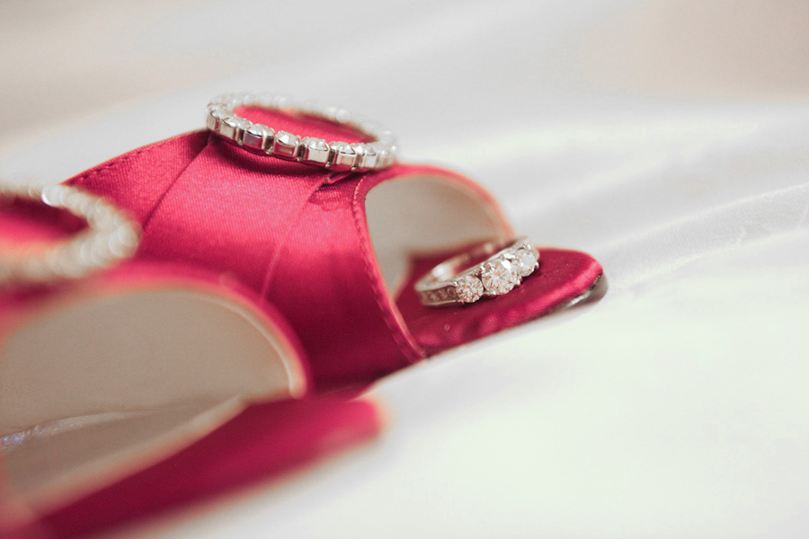 engagement ring on bright coloured wedding shoes