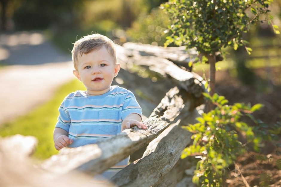 one year old boy at fence