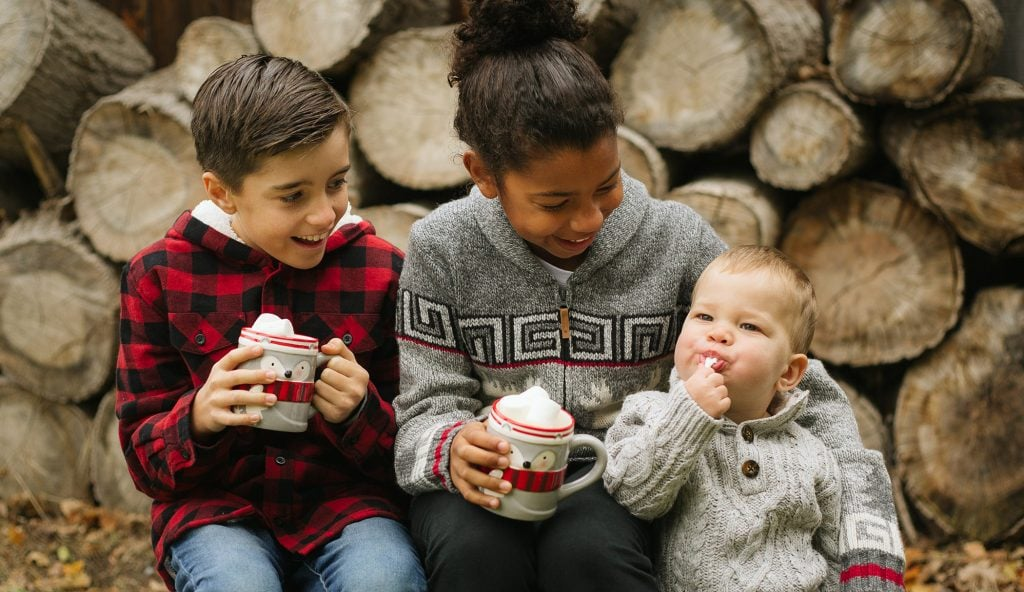kids at tree farm with hot chocolate and marshmallows