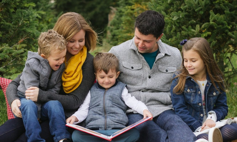 family reading christmas book