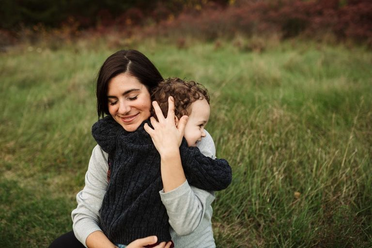 boy hugging mom fall family session whitby