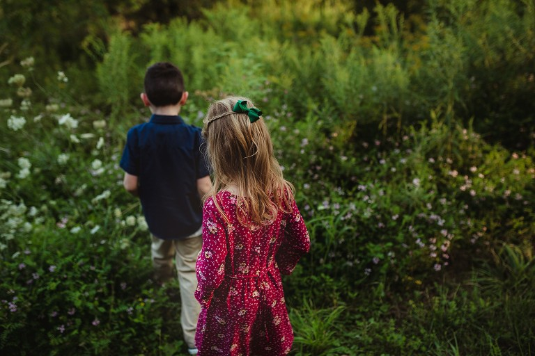 kids walking through field from behind in bowmanville