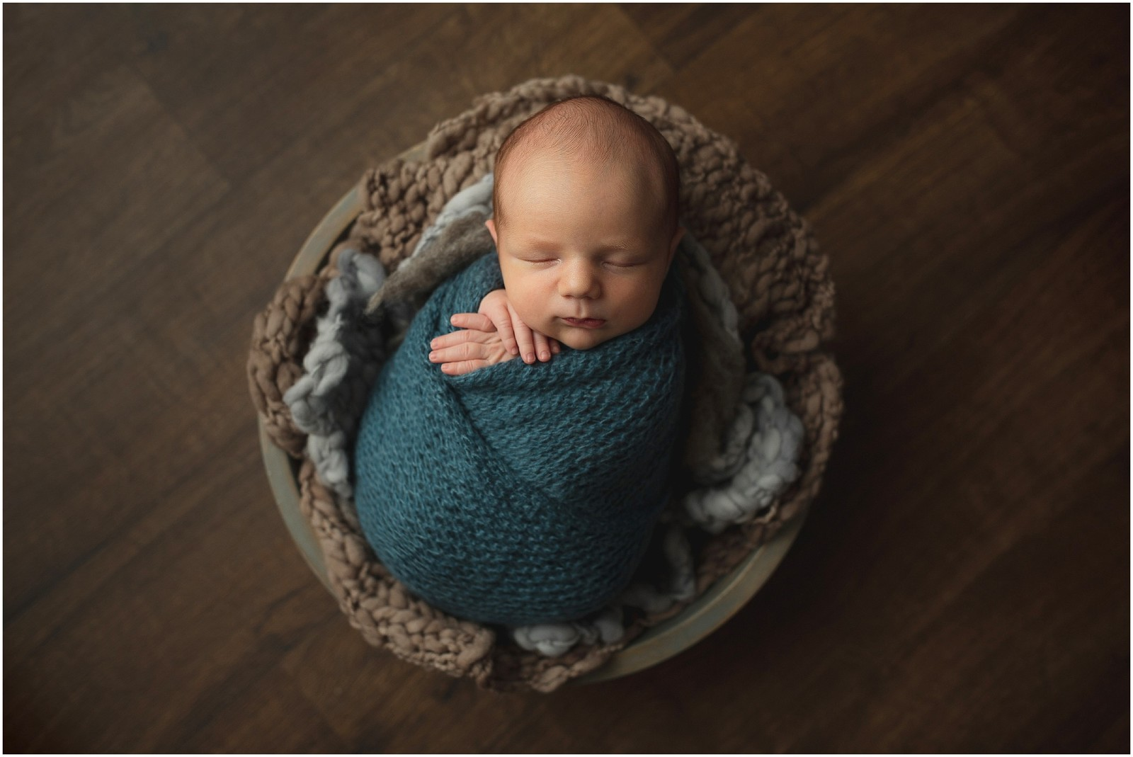 baby boy in bowl wrap technique