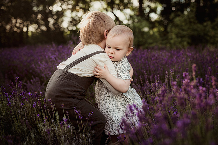 siblings at lavender farm hugging